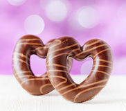 Chocolate hearts on purple backgroud Royalty Free Stock Photo