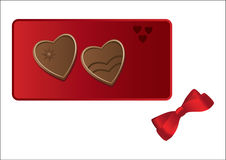 Chocolate hearts on the red. Fancy heart-shaped chocolate sweets on the red tin box with a ribbon bow beside isolated on white Stock Image