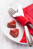 Chocolate hearts and silverware on plate for Valentines Royalty Free Stock Photos
