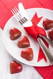 Chocolate hearts and silverware on plate for Valentines Stock Image