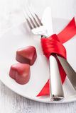 Chocolate hearts and silverware on plate for Valentines Royalty Free Stock Photography