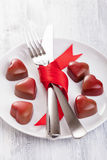 Chocolate hearts and silverware on plate for Valentines Royalty Free Stock Photo