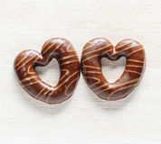 Chocolate hearts on white wooden table. Royalty Free Stock Photography