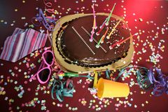 Chocolate holiday party cake on a messy table Stock Photo
