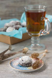 Chocolate homemade cookies in powdered sugar with tea and caramel sugar Royalty Free Stock Image