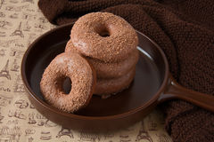 Chocolate homemade donuts. On brown newspaper background Royalty Free Stock Photos