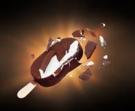 Chocolate ice cream broken into pieces in the dark.  stock photo