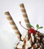 Chocolate ice cream with cherry. Chocolate ice cream in the cristal glass Royalty Free Stock Photo