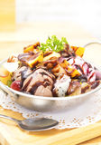 Chocolate ice cream with fruit in a bowl placed on wood  background Royalty Free Stock Images