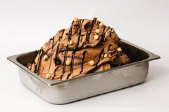 Chocolate ice cream with hazelnuts in the metal tray Royalty Free Stock Image