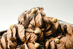 Chocolate ice cream with hazelnuts in the metal tray Stock Photo