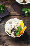 Chocolate Ice cream with orange and mint Royalty Free Stock Image