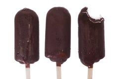Chocolate ice cream, a piece bitten off, part eaten Royalty Free Stock Photos