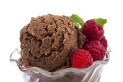 Chocolate ice cream with raspberry and mint. Closed up chocolate ice cream with raspberry and mint Stock Image