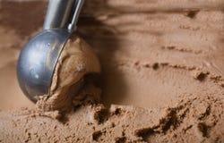 Chocolate ice cream scoop. Scooping chocolate ice cream up Stock Photo