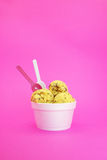 Chocolate ice cream. Served in white cups with a spoon and a yellow background Stock Image