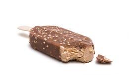 Chocolate ice cream on stick isolated. On white background royalty free stock image