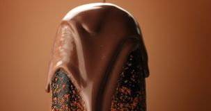 Chocolate ice cream on a stick and liquid chocolate covered it. Different chocolate textures Stock Image
