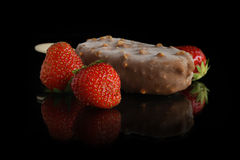 Chocolate ice cream and strawberries Stock Images