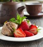 Chocolate ice cream with strawberries Stock Image