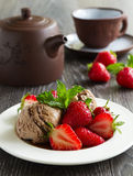 Chocolate ice cream with strawberries Stock Images