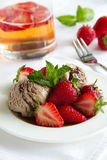 Chocolate ice cream with strawberries Royalty Free Stock Image