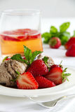 Chocolate ice cream with strawberries Stock Photography