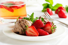 Chocolate ice cream with strawberries Royalty Free Stock Photos