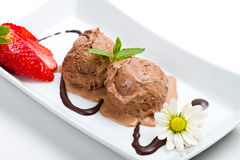 Chocolate ice cream with syrup close up Stock Images