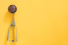 Chocolate ice cream on yellow background Royalty Free Stock Images