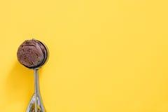 Chocolate ice cream on yellow background Stock Photo