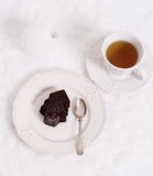 Chocolate ice dessert in form of Christmas tree with tea Royalty Free Stock Images