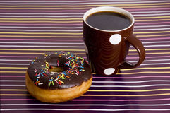 Chocolate Iced Donut And Coffee Royalty Free Stock Images