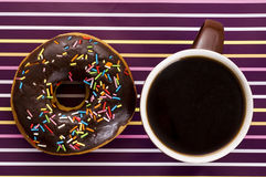 Chocolate iced donut and coffee Stock Images