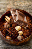 Chocolate with ingredients. On wood bowl royalty free stock photography