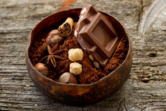 Chocolate with ingredients. On wood bowl royalty free stock images