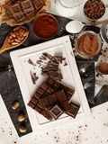 Chocolate making off. Chocolate and ingredients from above Royalty Free Stock Photos