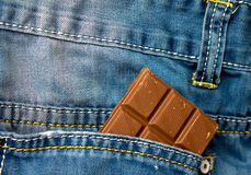 Chocolate in a jeans pocket Stock Image