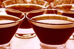 Chocolate jelly close-up on full background. Chocolate jelly  in glass pialas arranged on full background. horizontal  image Royalty Free Stock Image