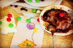 Chocolate jelly. In chocolate glaze on a background cat embroidery with colorful balloons and sweets Stock Photo