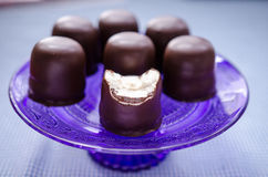 Chocolate kisses. With coffee cream filling stock photos