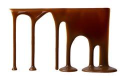 Chocolate líquido que fluye abajo Fotos de archivo