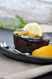 Chocolate Lava Cake with Lemon and Peach Topping Royalty Free Stock Image