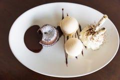 Chocolate lava cake set with ice cream on white plate Royalty Free Stock Photo