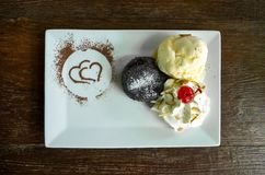 Chocolate lava cake  with vanilla ice cream on dark table background. Texture royalty free stock photos