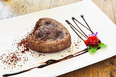 Chocolate Lava Cake. On white dish stock photos