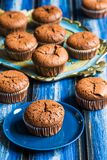 Chocolate lava muffins. On a blue wooden board royalty free stock images