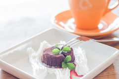 Chocolate lava with orange coffee cup Stock Photography