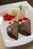 Chocolate lava pancake. With vanilla ice cream and fresh Strawberry royalty free stock images