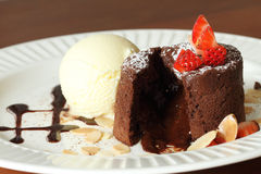 Chocolate lava with vanilla ice cream. And strawberry Royalty Free Stock Image